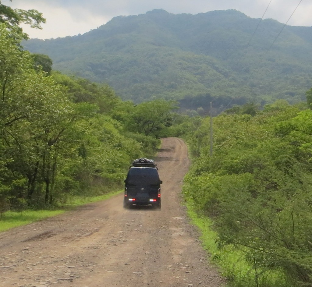 Driving down a dirt road in a mountainous area
